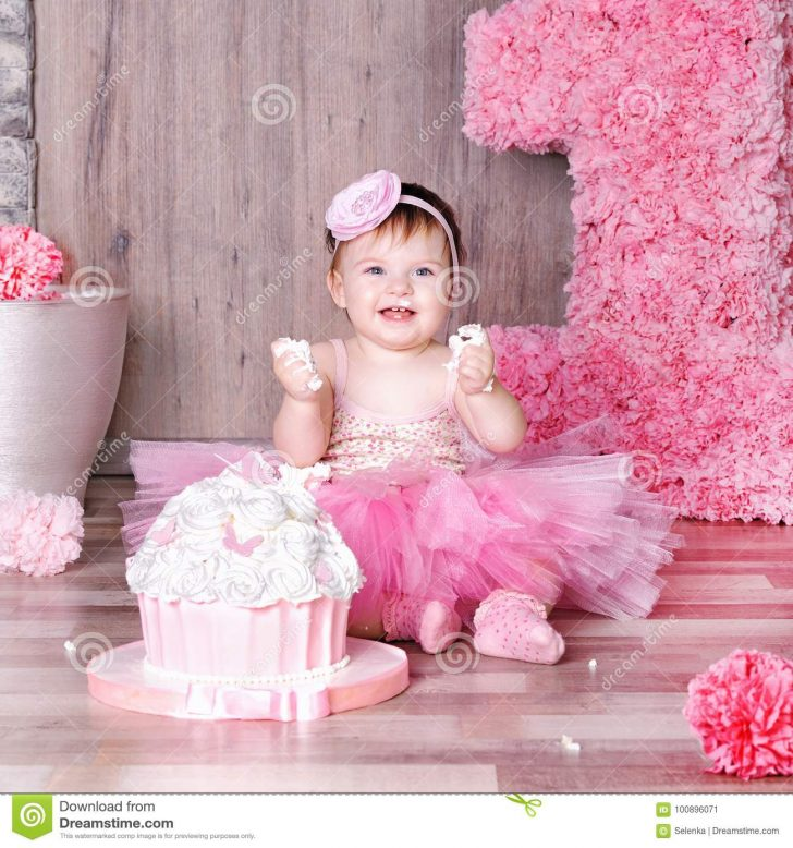 Baby Girl Birthday Cake 1 Year Ba Girl In Pink Dress With Her First Birthday Cake Stock