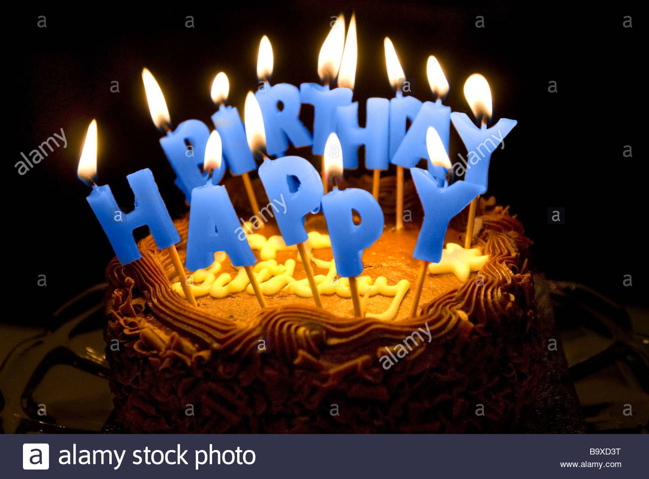 Birthday Cakes With Candles A Birthday Cake With Lighted Letter Candles Spelling Happy Birthday
