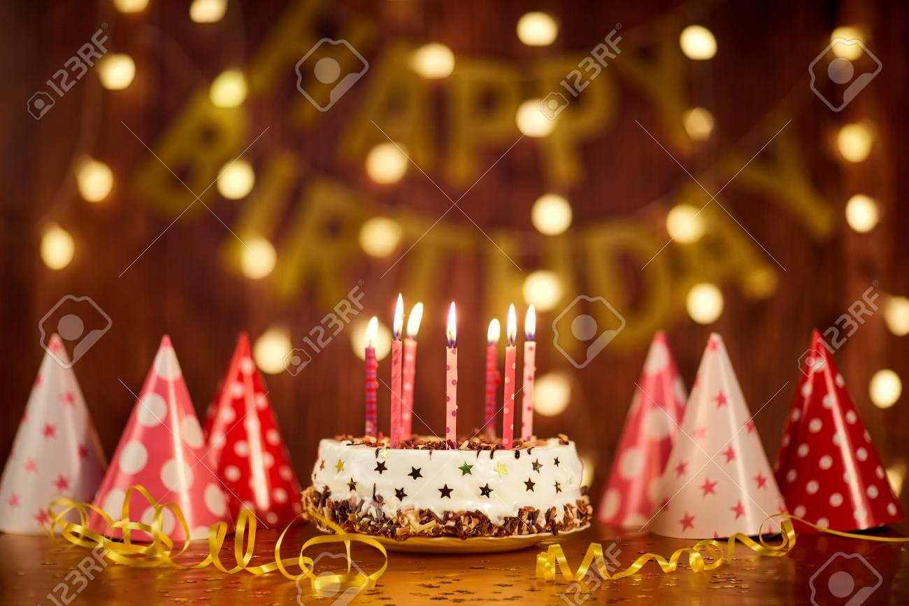 Happy Birthday Cake With Candles Happy Birthday Cake With Candles On The Background Of Garlands