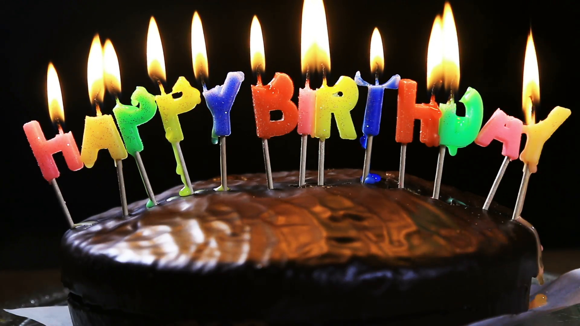 Happy Birthday Cake With Candles Lighted Candles On A Happy Birthday Cake Candles With The Words