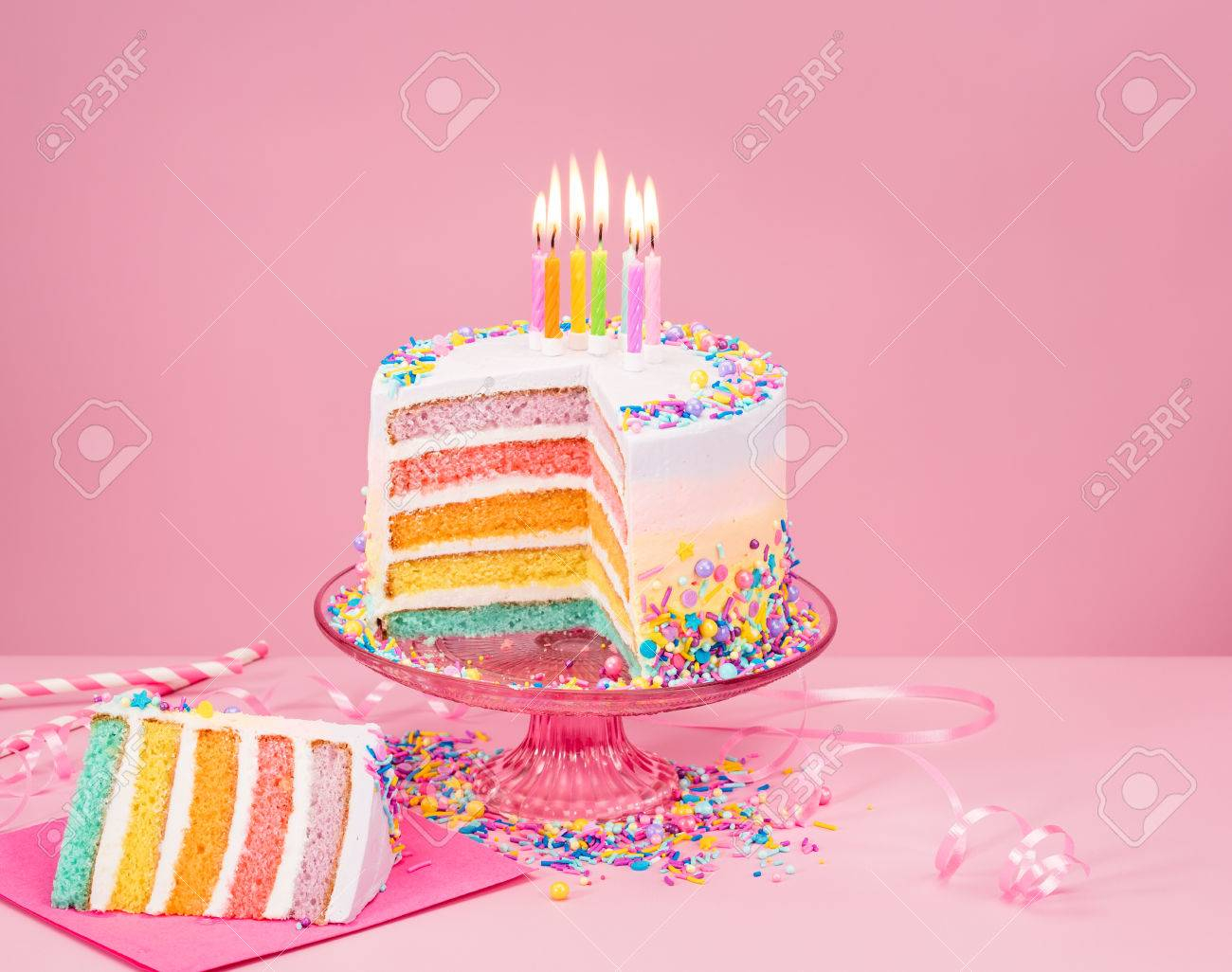 Rainbow Birthday Cake Colorful Rainbow Birthday Cake And With Candles Over A Pink