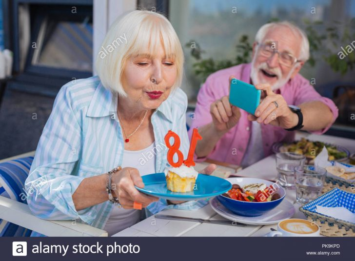 Woman Birthday Cake Positive Aged Woman Holding A Plate With Birthday Cake Stock Photo